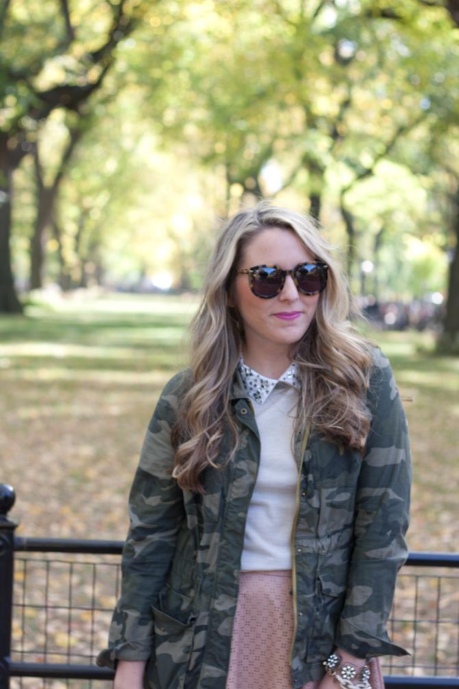 Camo jacket and Karen Walker sunglasses