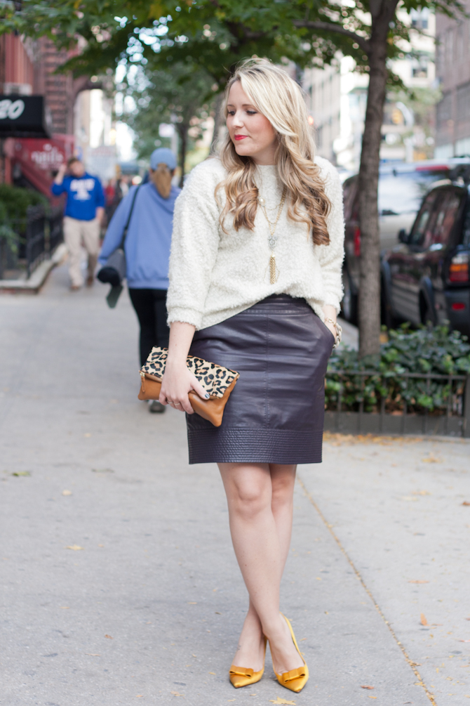 Teddy sweater and Faux Leather skirt with gold accessories