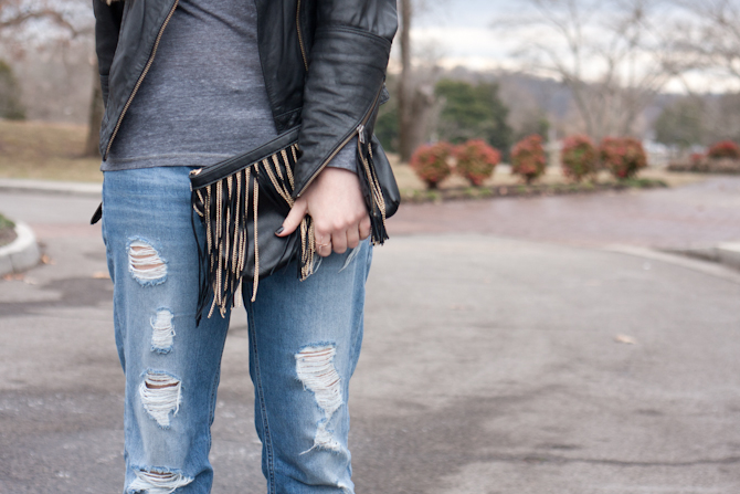 Black and gold fringe bag and boyfriend jeans