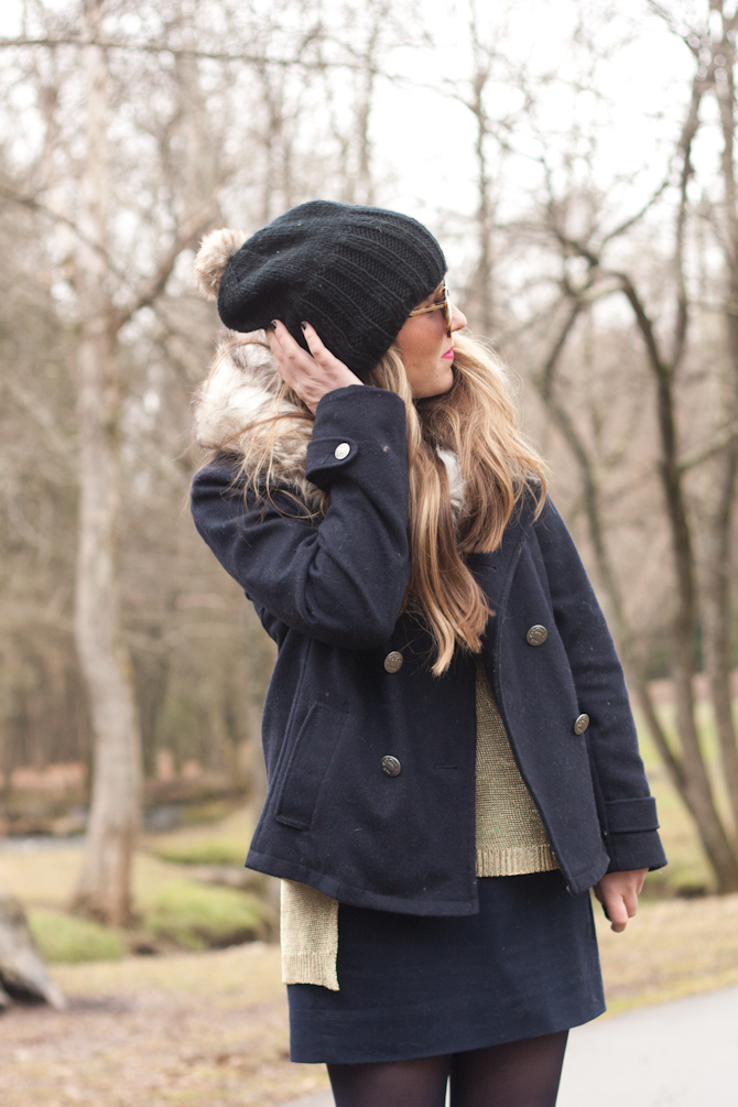 Navy pea coat and knit beanie with faux fur