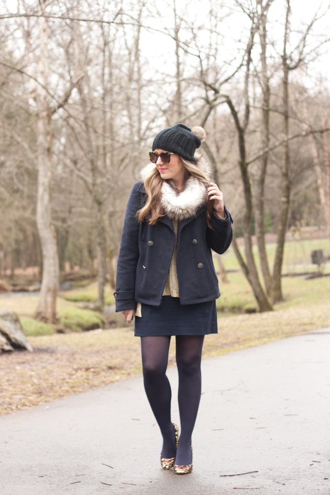 Navy tights and jacket with a faux fur snood and sparkle pumps