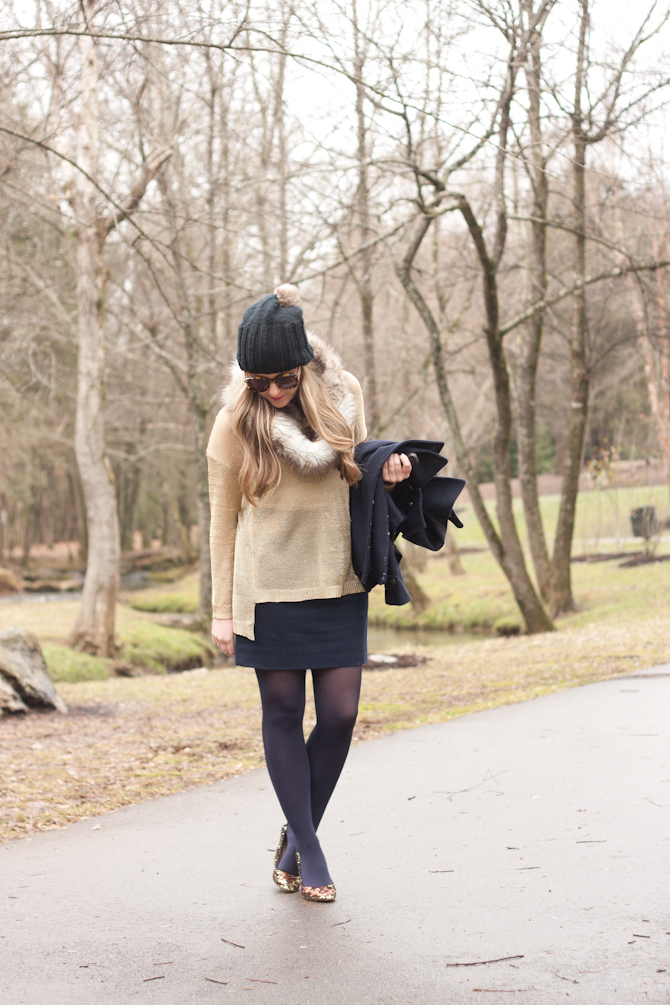Gold sweater, faux fur snood and gold pumps