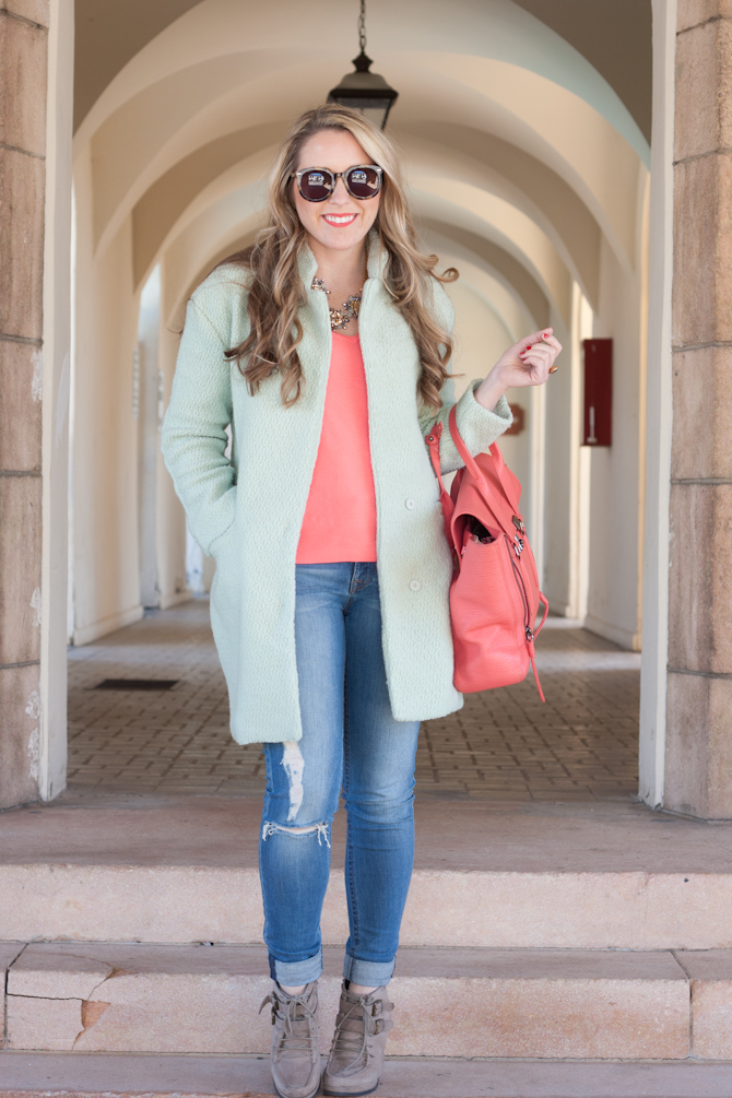 Mint coat with coral sweater and bag