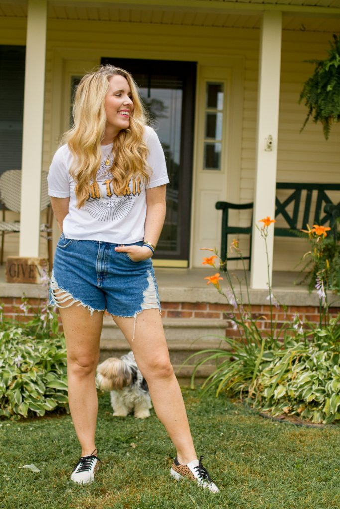 The Best of Denim Shorts for Thick Thighs featured by top Nashville fashion blogger, Pearls and Twirls: image of a woman wearing Topshop mom shorts