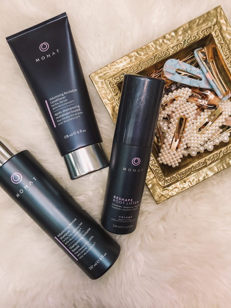 How to start using MONAT Hair Products, tips featured by top Nashville Beauty blogger, Pearls and Twirls. |Monat Business by popular Nashville lifestyle blog, Pearls and Twirls: image of Monat hair products next to a gold dish containing various hair clips.