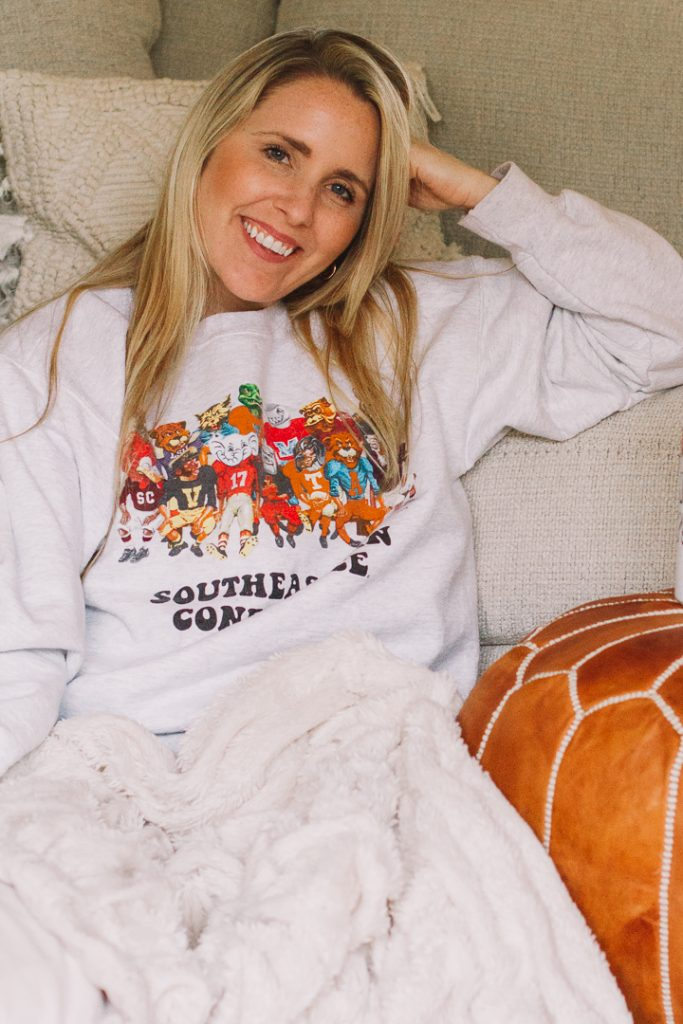 SEC Gameday by popular Nashville fashion blog, Pearls and Twirls: image of a woman wearing a My Kind of Lovely SEC Family Gameday sweatshirt.