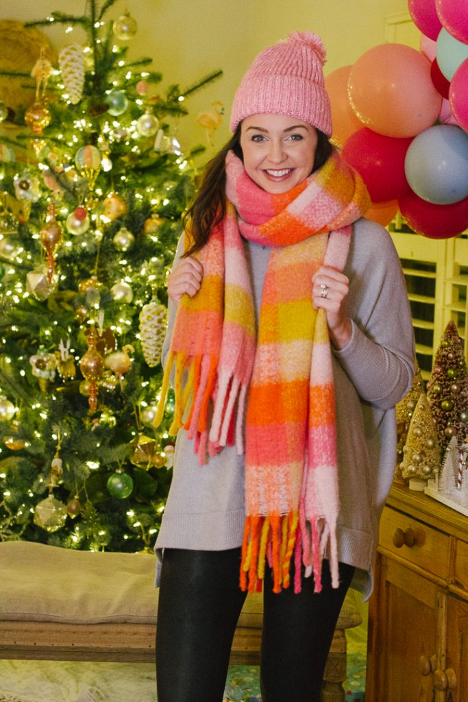 Christmas My Kind of Lovely |My Kind of Lovely Christmas |My Kind of Lovely by popular Nashville fashion blog, Pearls and Twirls: image of a My Kind of Lovely plaid scarf and pink pom beanie.