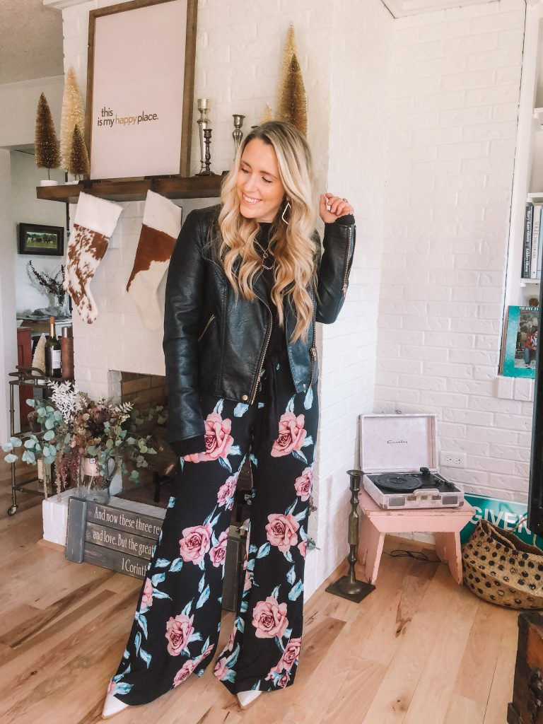 Have Fun This Christmas by popular Nashville lifestyle blog, Pearls and Twirls: image of a woman wearing a black leather jacket from Nordstrom and wide leg floral pants.