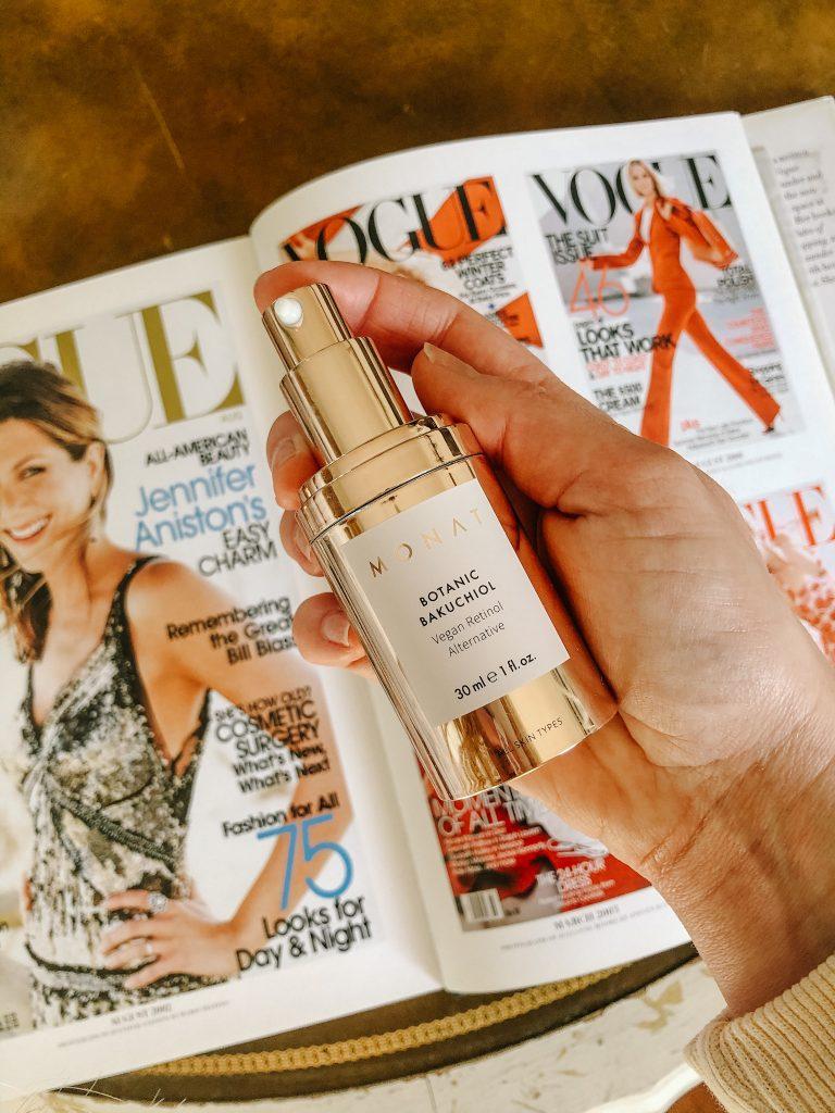 Monat Bakuchiol Review by popular Nashville beauty blog, Pearls and Twirls: image of a woman holding a bottle of Monat Botanc Bakuchiol Vegan Retinol Alternative.
