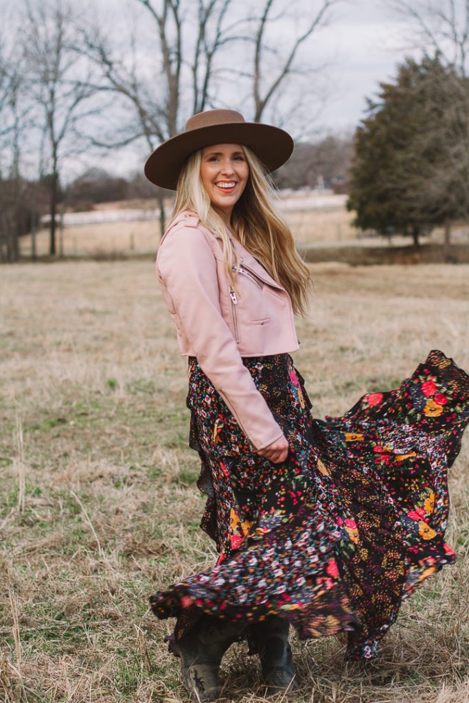 how to get inspired for 2021 |How to Get Unstuck by popular Nashville lifestyle blog, Pearls and Twirls: image of a woman standing in a field and wearing a Charlie 1 Horse felt boater hat, Nuuly pink leather jacket, and Nuuly maxi ruffle floral print skirt.
